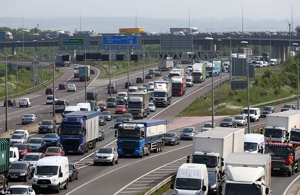 Traffic queues along the M25 in Dartford, Kent, as the Bank Holiday and half term rush begins. Millions of people will be making journeys across the weekend.