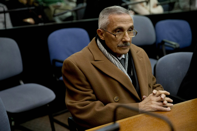 Former intelligence officer Miguel Angel Furci sits in federal court for his sentencing in Buenos Aires, Argentina, Friday, May 27, 2016. The court is delive...