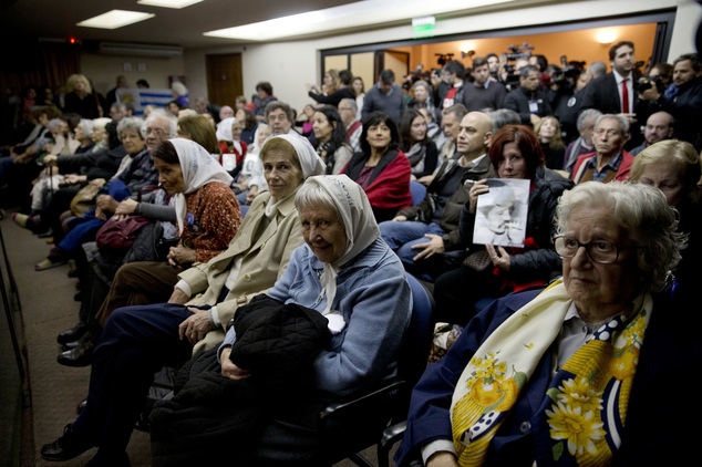 People sit in federal court for the sentencing of former military officers in Buenos Aires, Argentina, Friday, May 27, 2016. The court will deliver a sentenc...