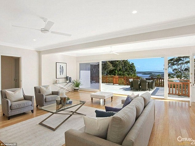 Living room: The spacious living area unfolds onto a terrace with sweeping breathtaking views of Palm Beach - famously known as 'Summer Bay'