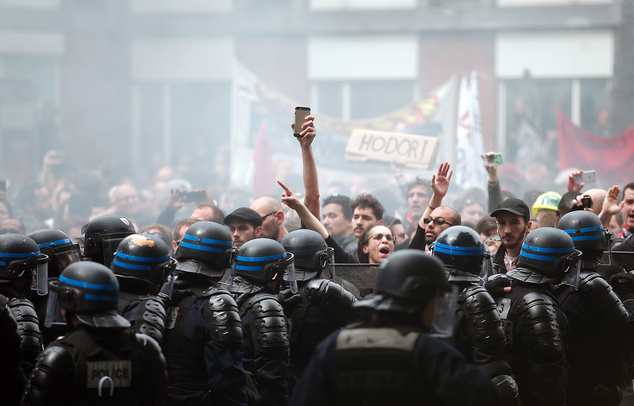 Protestors face riot police officers during a demonstration held as part of nationwide labor actions in Paris, Thursday, May 26, 2016. Paris police have deta...