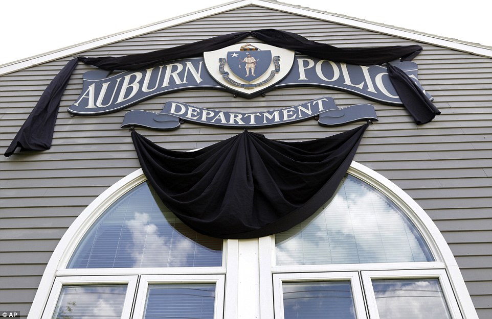 Tarentino's wife thanked all those who had shared uplifting stories about her husband Friday. Pictured on Monday,  Auburn police station's sign draped in black in his memory