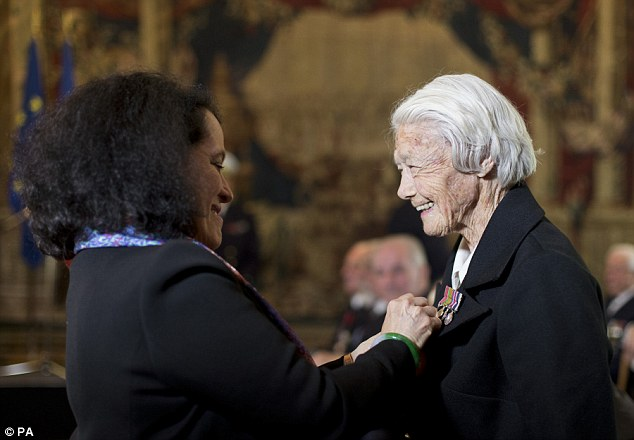 Veteran Marsie Taylor (right), 96, was presented with her medal by French Ambassador Sylvie Bermann for her role in the liberation of France at a ceremony in London