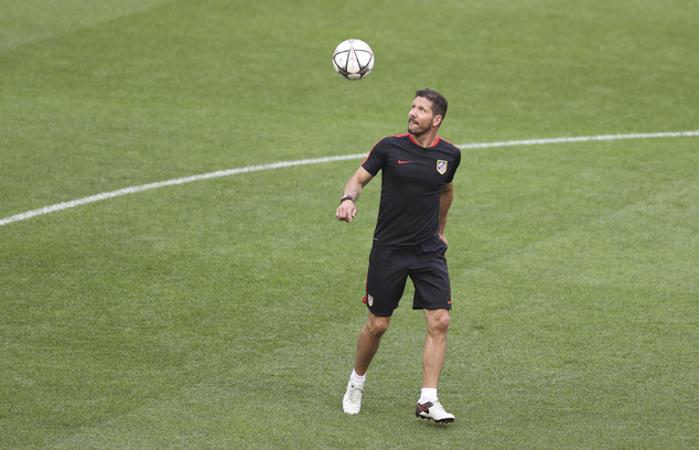Atletico's coach Diego Simeone looks at the ball as he leads a training session at the San Siro stadium in Milan, Italy, Friday, May 27, 2016. The Champions ...