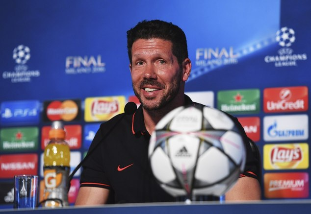 In this photo provided by UEFA Atletico Madrid's head coach Diego Simeone smiles during a press conference at the San Siro stadium in Milan, Italy, Friday, M...