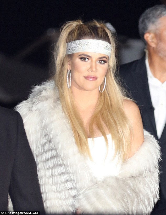 Hoops: Khloe's fancy ensemble included some big hoop earrings