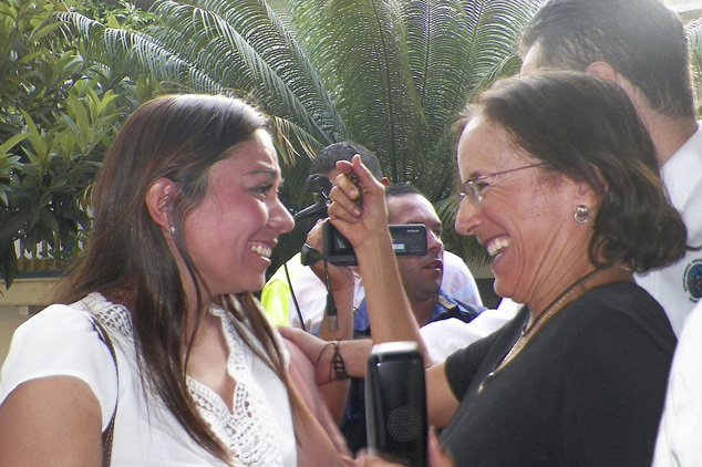 Salud Hernandez-Mora, right, correspondent in Colombia for Spain's El Mundo and columnist for the Bogota daily El Tiempo, is greeted by Melisa Gomez after Sa...