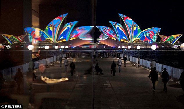 The Sydney Opera House, featuring projected art, is reflected in a hotel window during the opening night of the annual Vivid Sydney light festival in Sydney