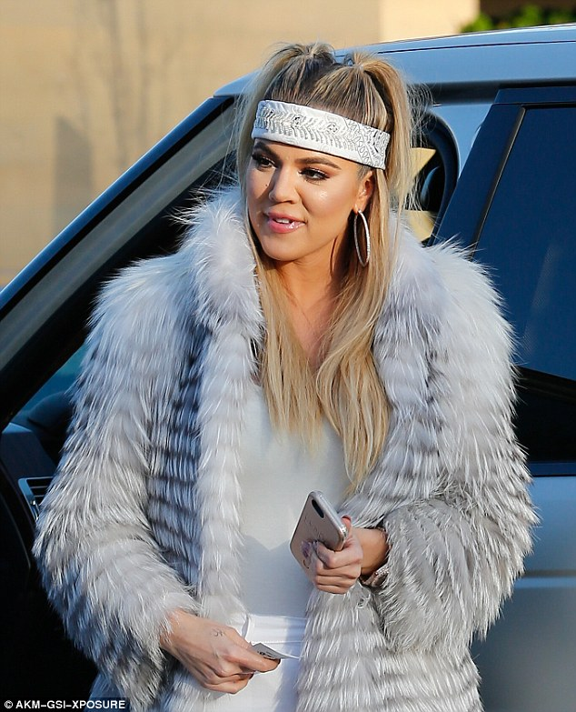 She rocks: The 31-year-old wore her blonde hair in two topknot ponytails that cascaded over a glittery white headband
