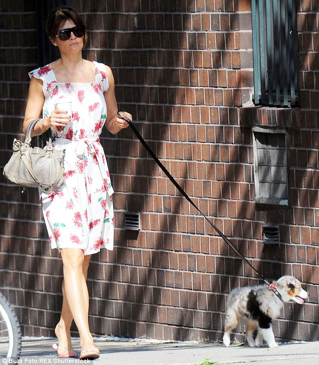 It's a dog's life! Helena Christensen looked as though she was in the throes of puppy love as she took her cute canine companion, Kuma, on a stroll through New York City on Thursday