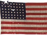 """This photo obtained June 3, 2016 courtesy of Heritage Auctions shows The 48-Star US flag that led the first American troops to Utah Beach on D-Day, June 6, 1944, replete with a bullet hole from a German machine gun.  The flag will go to auction in Dallas, Texas on June 12, 2016. It will be sold as part of Heritage Auctions Arms & Armor/Civil War & Militaria SignatureÆ Auction and is expected to bring more than $100,000 USD. / AFP PHOTO / Heritage Auctions / Handout / RESTRICTED TO EDITORIAL USE - MANDATORY CREDIT """"AFP PHOTO / HERITAGE AUCTIONS"""" - NO MARKETING NO ADVERTISING CAMPAIGNS - DISTRIBUTED AS A SERVICE TO CLIENTS HANDOUT/AFP/Getty Images"""