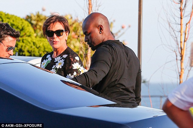 Gang's all here: Momager Kris Jenner, 60, was in a celebratory mood as she arrived to the party with Corey