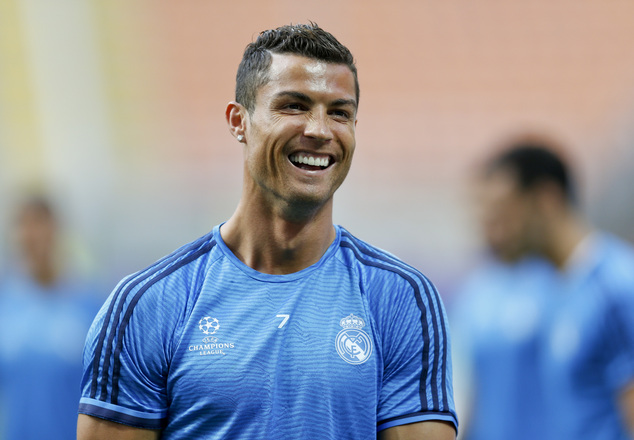 Real Madrid's Cristiano Ronaldo smiles during a training session at the San Siro stadium in Milan, Italy, Friday, May 27, 2016. The Champions League final so...