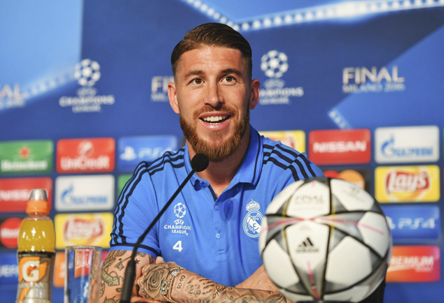 In this photo provided by UEFA, Real Madrid's Sergio Ramos smiles during a press conference at the San Siro stadium in Milan, Italy, Friday, May 27, 2016. Th...