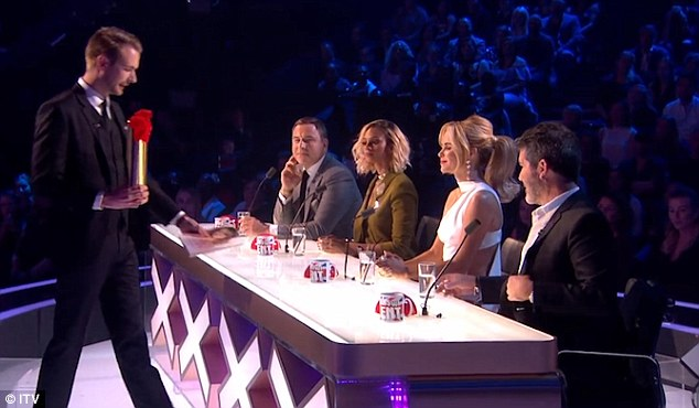 Richard approached Simon Cowell with a bottle in a gold case and asked him to guard it