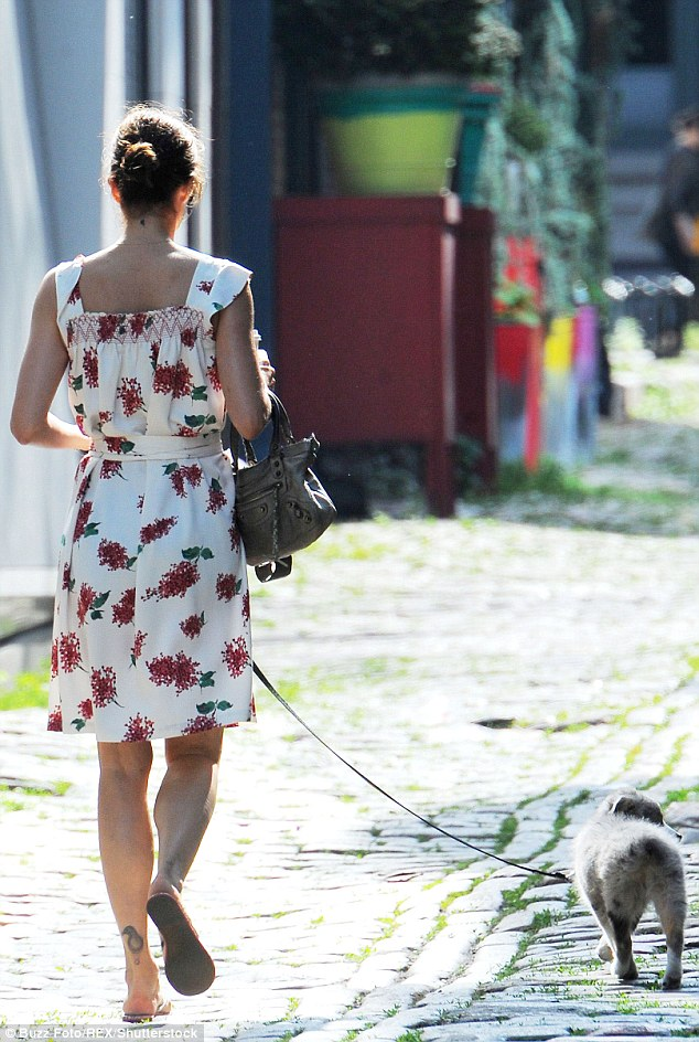 Flower power: Accentuating her slim figure, Helena's chic white ensemble featured a flattering belt to cinch in her waist and was adorned with bold red flowers