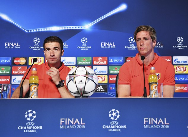 In this photo provided by UEFA Atletico Madrid players Fernando Torres, right, and Gabi attend a press conference at the San Siro stadium in Milan, Italy, Fr...