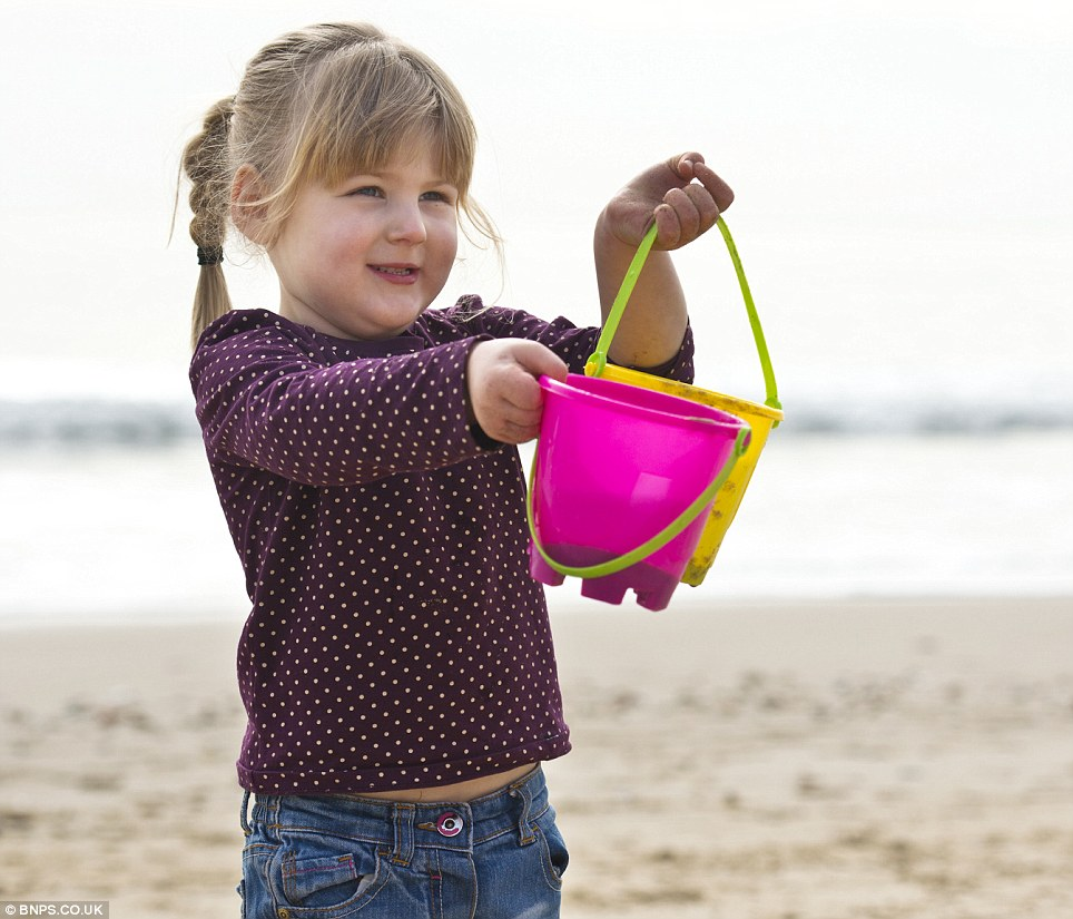 'I need more sand': Ashleigh Cole, three, travelled with her family from Portsmouth to Bournemouth to enjoy the seaside