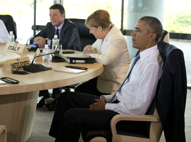 U.S. President Barack Obama, right, Italian Prime Minister Matteo Renzi, left, and German Chancellor Angela Merkel participate in a G-7 Working Session in Sh...