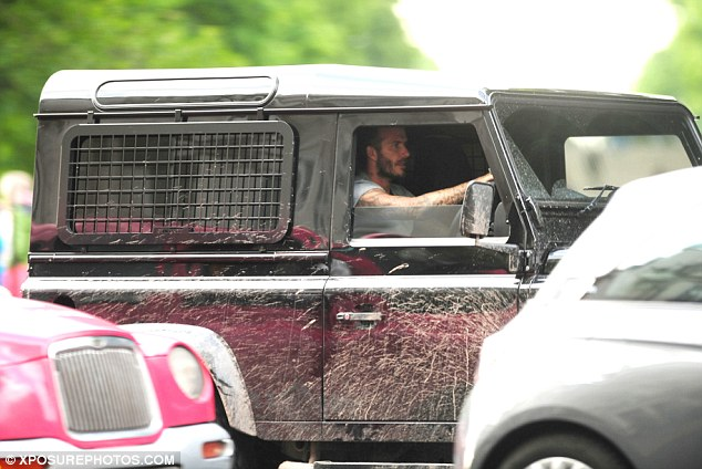 Dirty boy: Flouting the big city etiquette of driving a clean and shiny motor, David Beckham seemed intent on bringing a bit of the country back to the town when he went for a drive in London on Thursday