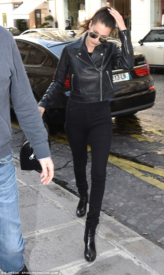 Tight updo: Bella kept adjusting her sleek, high ponytail as she emerged from her taxi