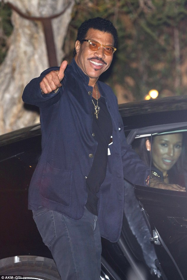 His leading lady: Lionel Richie, 66, was joined at the party by his long-term girlfriend Lisa Parigi, who was photographed in the back of his car as he left the bash