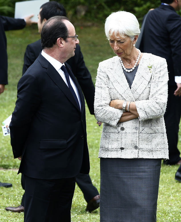 French President Francois Hollande, left, speaks with International Monetary Fund Managing Director Christine Lagarde  during the family photo session at the...