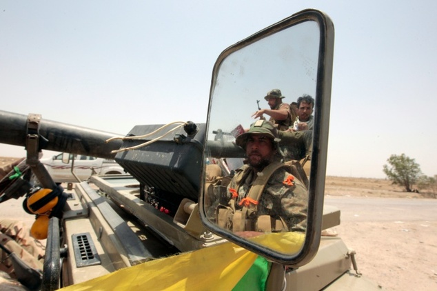 Iraqi pro-government forces drive in an area between the village of al-Sejar and Fallujah, on May 28, 2016, as they take part in a major assault to retake th...