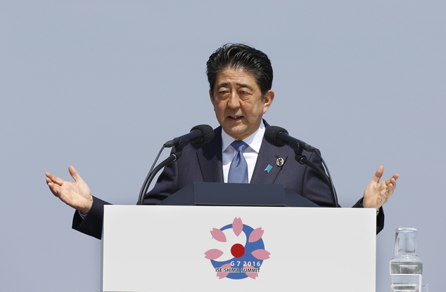 Japanese Prime Minister Shinzo Abe speaks at a press conference at the G-7 summit in Shima, central Japan, Friday, May 27, 2016. (AP Photo/Shizuo Kambayashi)