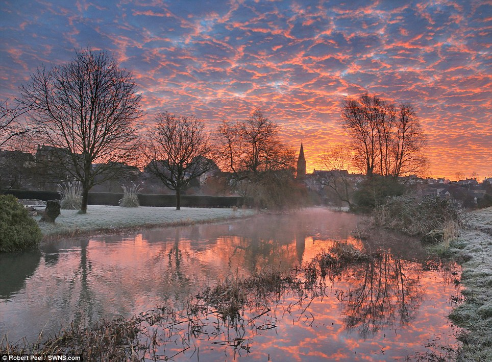 Chilly start: Some areas, including Malmesbury in Wiltshire, were covered in frost this morning, but the mercury is set to rise as the week goes on