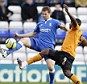 Spot the fans: Jonathan Spector and Sylvan Ebanks-Blake fight for the ball in a half-empty St Andrew's