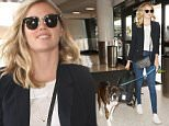 Model Kate Upton departs with her dog at LAX Airport in Los Angeles, CA.\n\nPictured: Kate Upton \nRef: SPL1294657  030616  \nPicture by: iPix211/London Ent/Splash News\n\nSplash News and Pictures\nLos Angeles: 310-821-2666\nNew York: 212-619-2666\nLondon: 870-934-2666\nphotodesk@splashnews.com\n