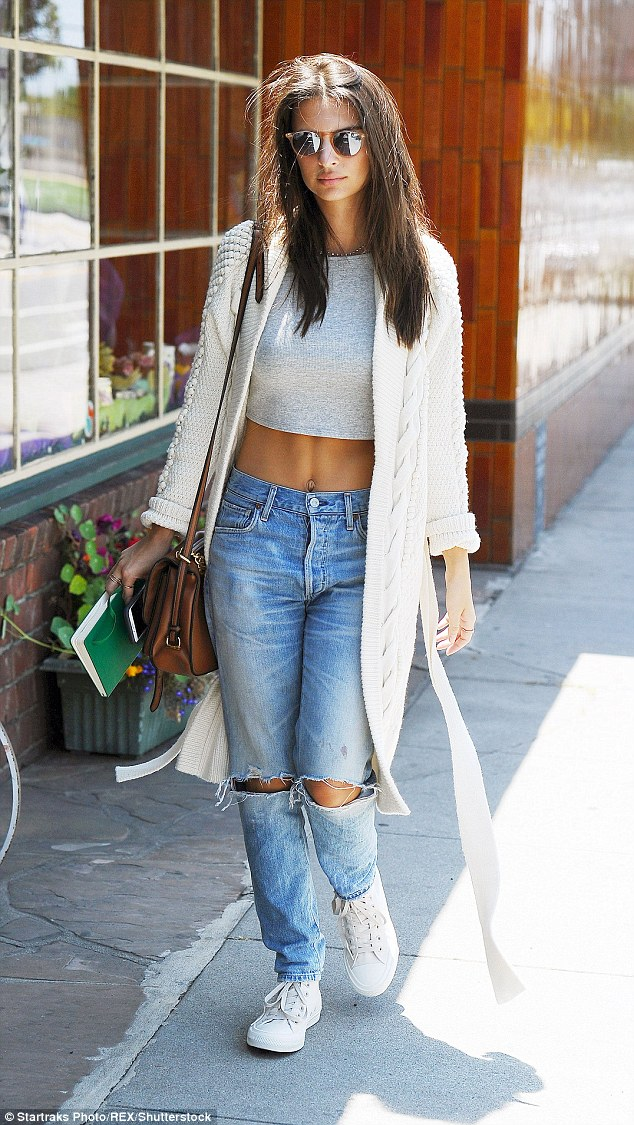 Envy-inducing: The 24-year-old model and actress turned heads as she flashed her extraordinarily toned abs in a teeny grey crop top and low-rise ripped jeans  by Citizens of Humanity jeans