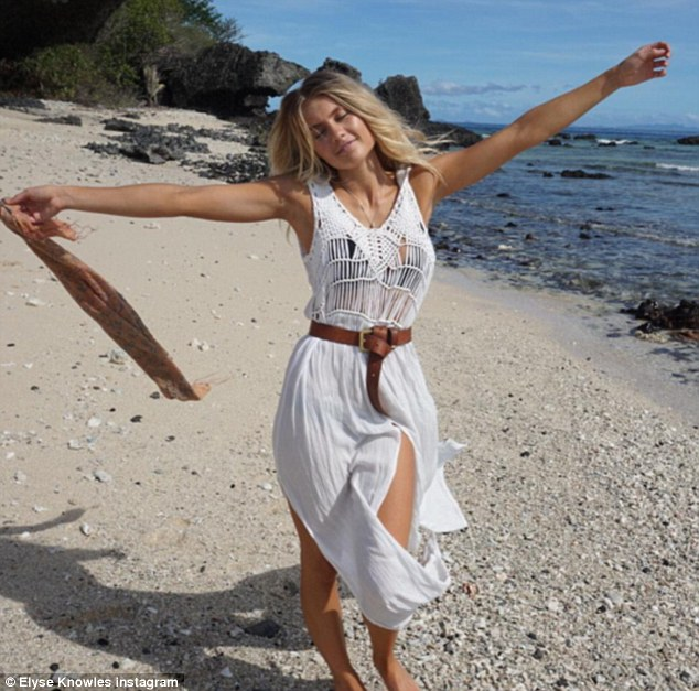 'I'm happy as can be': After touching down in Fiji on Friday, the blonde beauty shared this snap from the beach