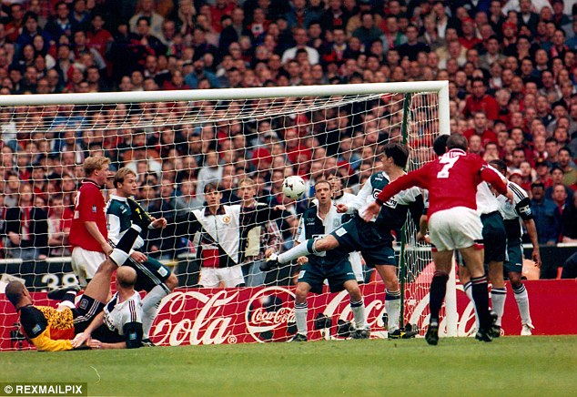 Cantona somehow finds the net from outside the box to win the 1996 Cup final for Man United