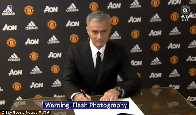 Mourinho was seen putting pen to paper on his contract in MUTV footage shown on Sky Sports News