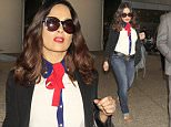 EXCLUSIVE: Salma Hayek arrives in LA amidst reports she tried to make her husband think she was having an affair to save a puppy.  The Mexican-American film actress was seen in a patriotic red, white & blue outfit.  Hayek was seen wearing blue jeans a white & blue blouse with a red scarf.\n\nPictured: Salma Hayek\nRef: SPL1295504  040616   EXCLUSIVE\nPicture by: Sharky/Poilite Paparazzi/Splash\n\nSplash News and Pictures\nLos Angeles: 310-821-2666\nNew York: 212-619-2666\nLondon: 870-934-2666\nphotodesk@splashnews.com\n