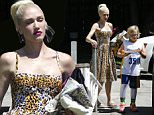 Hollywood, CA - Stylish mom Gwen Stefani brings major style to her son Zuma's basketball game on Saturday. The 46-year-old mother of three is wearing a leopard print pin up style dress with her signature red lip. By her side, Gwen carries a fuzzy Chanel clutch that adds a pop of color to compliment her makeup. Gwen keeps it comfy with her shoes wearing flip flops that are a curveball to her polished ensemble. Zuma is seen hanging out in his uniform while waiting for his superstar mom to take him home. \n  \nAKM-GSI       June 4, 2016\nTo License These Photos, Please Contact :\nMaria Buda\n(917) 242-1505\nmbuda@akmgsi.com\nsales@akmgsi.com\nMark Satter\n(317) 691-9592\nmsatter@akmgsi.com\nsales@akmgsi.com