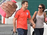 Pics Paul Cousans/Zenpix Ltd Mark Wright and Michele Keegan arrive hand in hand at their hotel as rumours have been rife that their marriage is on the rocks  Looking loved up mark put his arm around Michelle as she made her way into the hotel