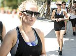 EXCLUSIVE TO INF. June 3, 2016: Singer Ellie Goulding shows off her fit figure while posing with friends and then taking a walk after working out at Barry's Bootcamp in Miami, Florida.  Mandatory Credit: INFphoto.com Ref: infusmi-11/13
