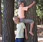 Two Boys Climbing a Tree in Forest.....A1BFR0 140010H image100 Assistance Childhood Teamwork Leaning 7 9 years Barefoot Whites Tree trunk Forest Friends Eye contact Full length Posed Support Outdoors Recreation EverydayCollection 2 wooded Woodland woods supporting supportive trunk full length full body kids young kid child posing pose gaze looking Caucasian team work co operate co operating co operation cooperate together team work team collaboration cooperative cooperating Cooperation recreational pastime outside lean camaraderie companionship pal companion Motion active climb action scaling movement youthfulness youthful Siblings boy Males barefooted bare foot barefeet bare helpful helping helpfulness help assisting human being two people only two People two people pair human Tree trunks Color Vertical Colour