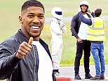 Picture Shows: The Stig, Anthony Joshua  June 02, 2016    * Min Web / Online Fee £50 Per Picture *    Professional boxer Anthony Joshua pictured squeezing himself into a Mini to perform a lap in a reasonably priced car segment for the third episode of the BBC's 'Top Gear' in London, England.    * Min Web / Online Fee £50 Per Picture *    EXCLUSIVE ALL ROUNDER  WORLDWIDE RIGHTS  Pictures by : FameFlynet UK © 2016  Tel : +44 (0)20 3551 5049  Email : info@fameflynet.uk.com