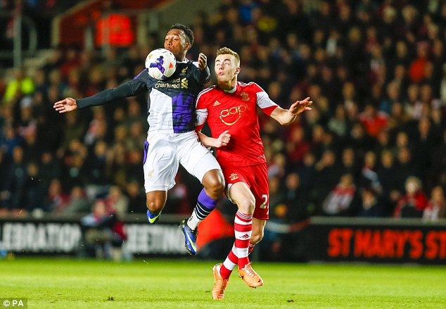 First team breakthrough: Calum Chambers, the England Under-19 captain, in action for Southampton's first team against Liverpool striker Daniel Sturridge last weekend