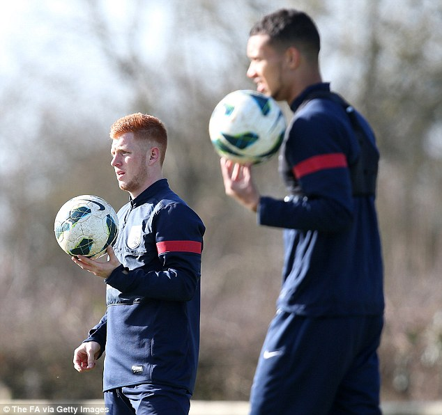 On the ball: Southampton call-up Harrison Reed (left) during training