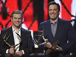 Matt Damon, left, and Ben Affleck accept the guys of the decade award at the Guys Choice Awards at Sony Pictures Studios on Saturday, June 4, 2016, in Culver City, Calif. (Photo by Chris Pizzello/Invision/AP)