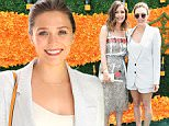 JERSEY CITY, NJ - JUNE 04:  Rose Byrne (L) and  Elizabeth Olsen attend the Ninth Annual Veuve Clicquot Polo Classic at Liberty State Park on June 4, 2016 in Jersey City, New Jersey.  (Photo by Jamie McCarthy/Getty Images for Veuve Clicquot)
