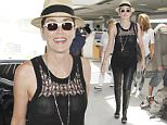 June 3, 2016: Actress Sharon Stone spotted at LAX Airport in Los Angeles, California. The 'Basic Instinct' star appeared to go braless while wearing a black knitted top, black leather pants and a straw fedora.\nMandatory Credit: INFphoto.com Ref: inf-00