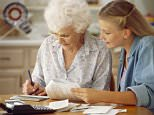 A woman and Grandmother are pictured sitting at a table paying bills --- Image by   Jose Luis Pelaez, Inc./CORBIS 2 Adults Assistance Bill Domestic scenes Elderly Everyday scenes Expenses Females Generations Granddaughter Grandmother Grandparent Holding Human relationships Indoors People Senior adult Whites