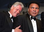 WASHINGTON, :  US President Bill Clinton leans on former world boxing heavyweight champion Muhammad Ali (R) at the National Italian American Foundation (NIAF) 25th Anniversary Awards Gala Dinner at a Washington DC hotel 28 October, 2000.  Ali and his trainer Angelo Dundee were honored with the NIAF One America award at the gathering. Founded in 1975 as a non-profit, non-partisan foundation, the NIAF works to preserve and protect Italian American heritage and culture.    AFP PHOTO/Manny CENETA (Photo credit should read MANNY CENETA/AFP/Getty Images)