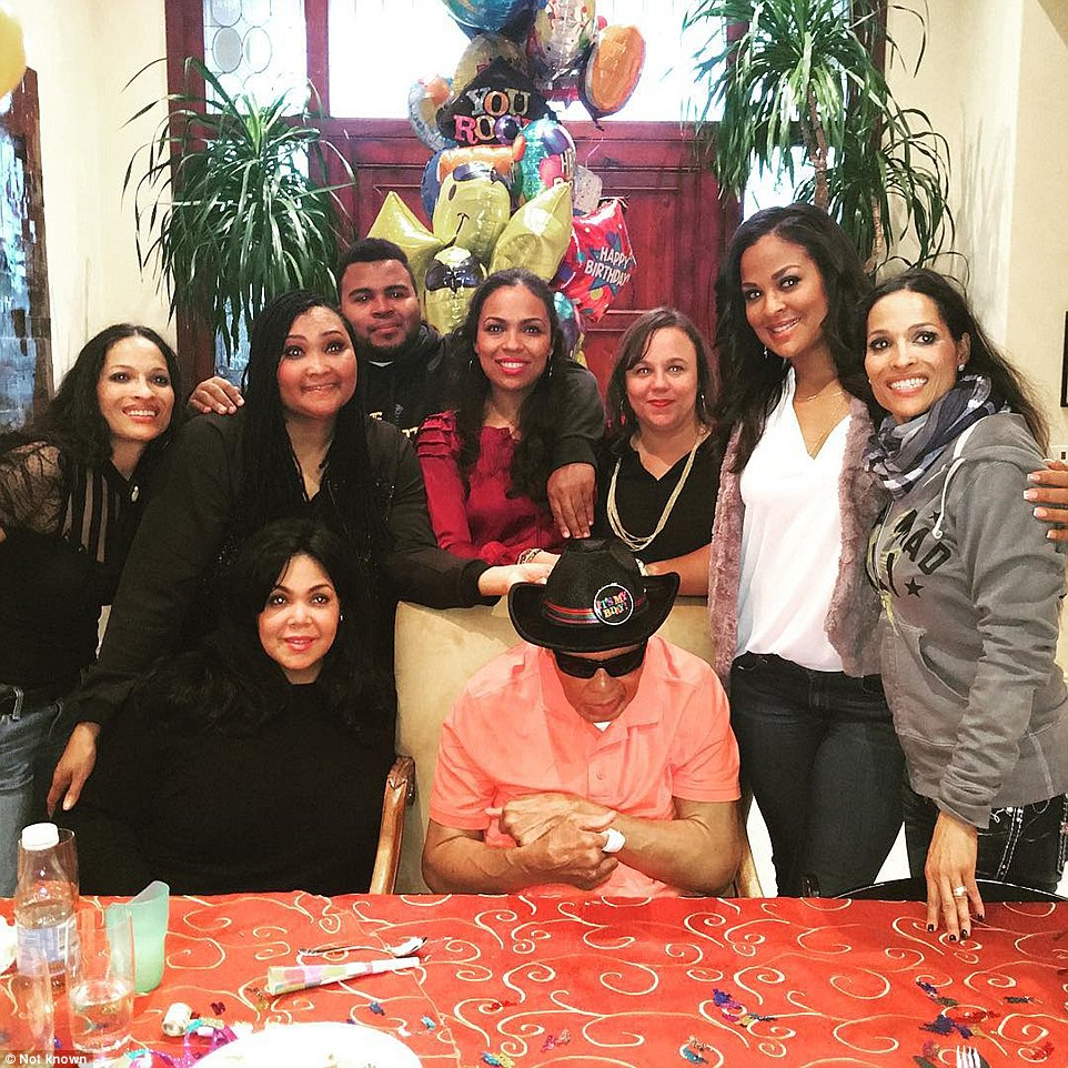 United front: Ali, center, with some of his children – (from left) Jamillah, Maryum (standing), Khaliah (sitting), adopted son Asaad, Hana, Miya, Laila and Rasheda